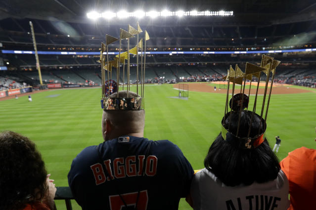 Fans watch batting practice before Game 6 of the baseball World Series between the Houston Astros and the Washington Nationals Tuesday, Oct. 29, 2019, in Houston. (AP Photo/Eric Gay)