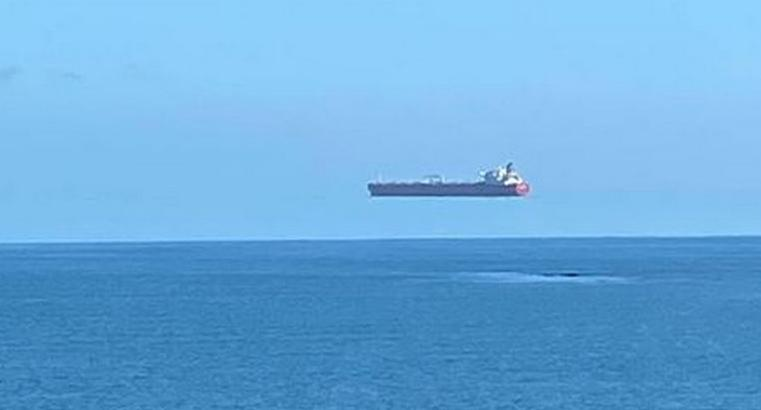 A ship appearing to float on thin air off the coast of Cornwall, England.