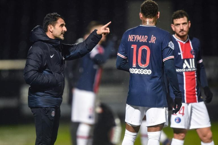 Assistant coach Jesus Perez (L) took charge of PSG in the absence of Mauricio Pochettino, who is isolating after testing positive for the coronavirus