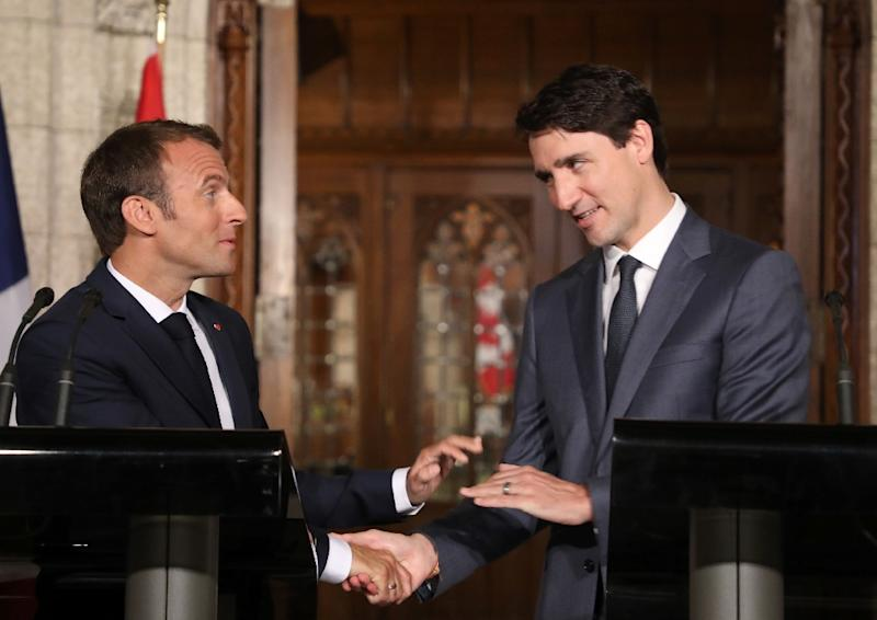 French President Emmanuel Macron (L) and Canadian Prime Minister Justin Trudeau (R) presented a common front in Ottawa before heading to the G7 summit (AFP Photo/LUDOVIC MARIN)
