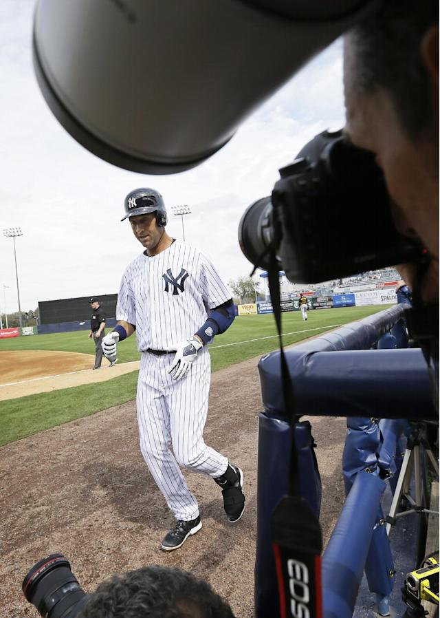 New York Yankees shortstop Derek Jeter walks back to the dugout after grounding out during the fourth inning of an exhibition baseball game against the Pittsburgh Pirates Thursday, Feb. 27, 2014, in Tampa, Fla. (AP Photo/Charlie Neibergall)