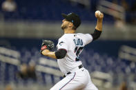 Miami Marlins relief pitcher Dylan Floro (36) delivers a pitch during the ninth inning of a baseball game against the Washington Nationals on Thursday, June 24, 2021, in Miami. (AP Photo/Mary Holt)