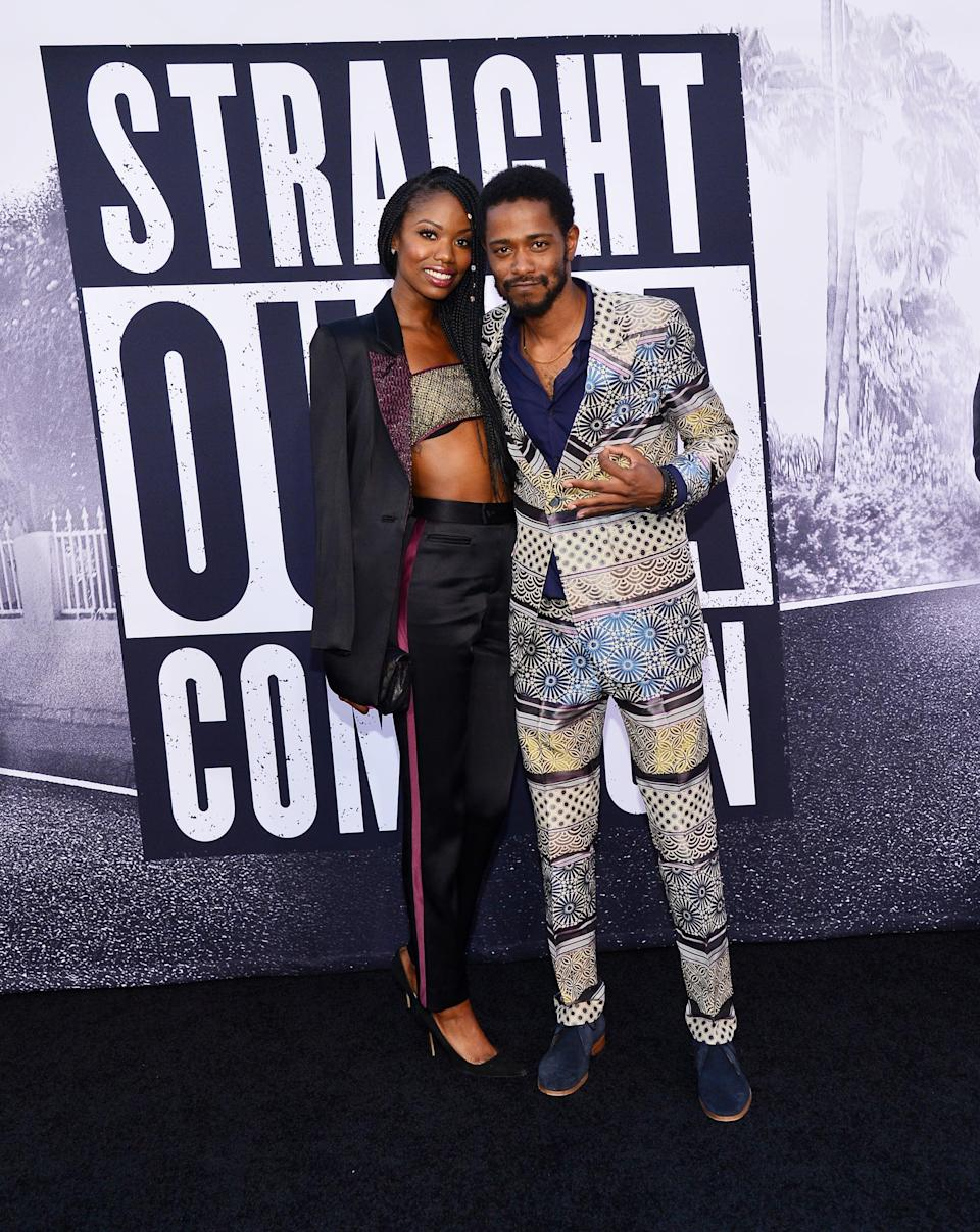 """<p>According to <strong>E! News</strong>, the couple <a href=""""http://www.eonline.com/news/834837/the-mindy-project-s-xosha-roquemore-is-expecting-first-child-with-lakeith-stanfield"""" class=""""link rapid-noclick-resp"""" rel=""""nofollow noopener"""" target=""""_blank"""" data-ylk=""""slk:made their debut red carpet appearance"""">made their debut red carpet appearance</a> at the <strong>Straight Outta Compton </strong>premiere, but it's possible they'd been dating before this. In the film, Stanfield starred as none other than Calvin Broadus Jr., aka <a href=""""https://www.popsugar.com/entertainment/snoop-dogg-frozen-let-it-go-car-video-47478180"""" class=""""link rapid-noclick-resp"""" rel=""""nofollow noopener"""" target=""""_blank"""" data-ylk=""""slk:Snoop Dogg"""">Snoop Dogg</a>.</p>"""