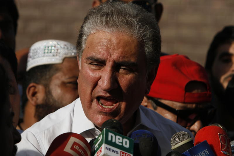 In this Friday Oct. 11, 2019 photo, Pakistan's Foreign Minister Shah Mahmood Qureshi speaks to reporters in Multan, Pakistan. Pakistan got a mixed review for its efforts to curb terrorist financing and money laundering as it tries to avoid being blacklisted by the Financial Action Task Force, a global watchdog, when it meets in Paris Wednesday, Oct. 16, 2019. Qureshi told reporters Friday that the economic affairs minister was already in Paris preparing for the meeting. He accused hostile neighbor India of lobbying to get Pakistan blacklisted. (AP Photo/Asim Tanveer)