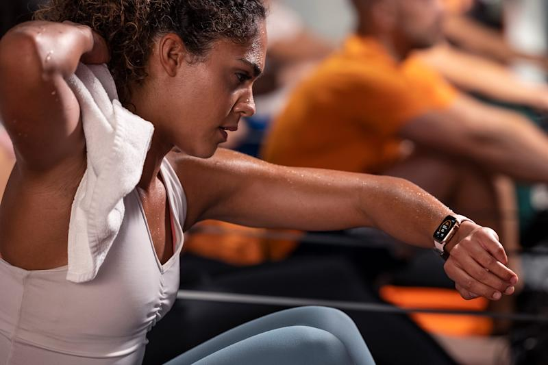A woman works out with her Apple Watch at Orangetheory.