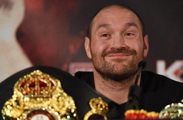 Tyson Fury (pictured) has not fought since his shock win against Wladimir Klitschko in November 2015 to become the undisputed heavyweight world champion (AFP Photo/Oli SCARFF)