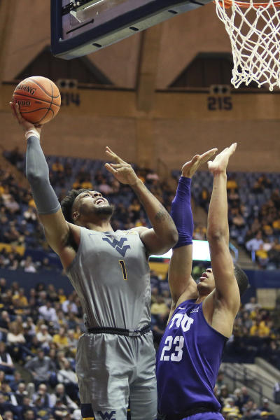 West Virginia forward Derek Culver (1) shoots as TCU forward Jaedon LeDee (23) defends during the second half of an NCAA college basketball game Tuesday, Jan. 14, 2020, in Morgantown, W.Va. (AP Photo/Kathleen Batten)