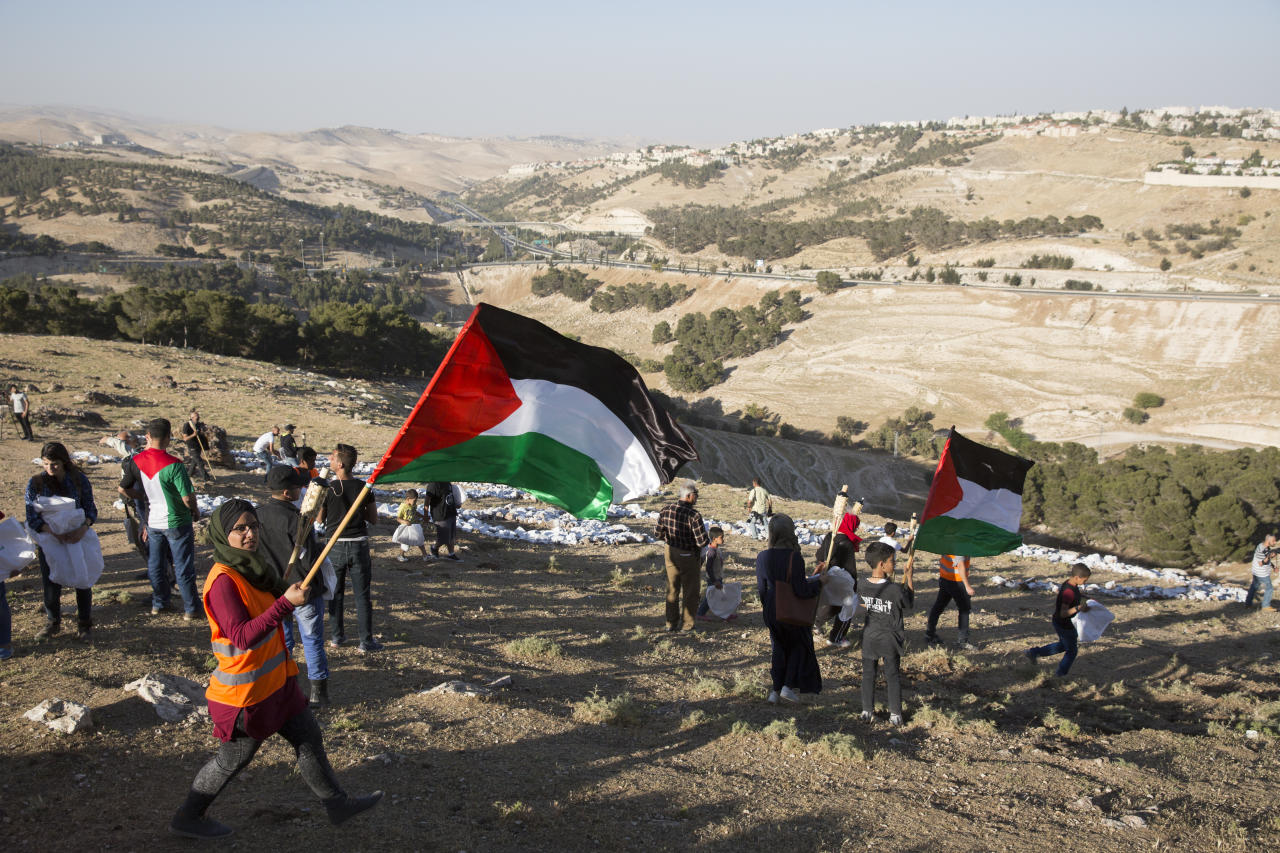 IMAGE DISTRIBUTED FOR AVAAZ - Families of Palestinian hunger strikers and members of a Palestinian Bedouin community facing demolition of their homes marched on Pope Mountain, near the Israeli settlement of Ma'ale Adumim, which is encroaching on their lands on the outskirts of Jerusalem, Friday, April 28, 2017. (Heidi Levine/AP Images for AVAAZ)