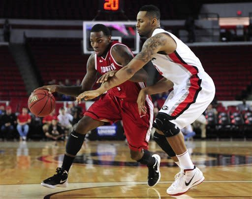 Youngstown State forward Kamren Belin, left, drives to the basket as Georgia forward Marcus Thornton (2) guards during an NCAA basketball game on Monday, Nov. 12, 2012, in Athens, Ga. (AP Photo/Athens Banner-Herald, Richard Hamm)