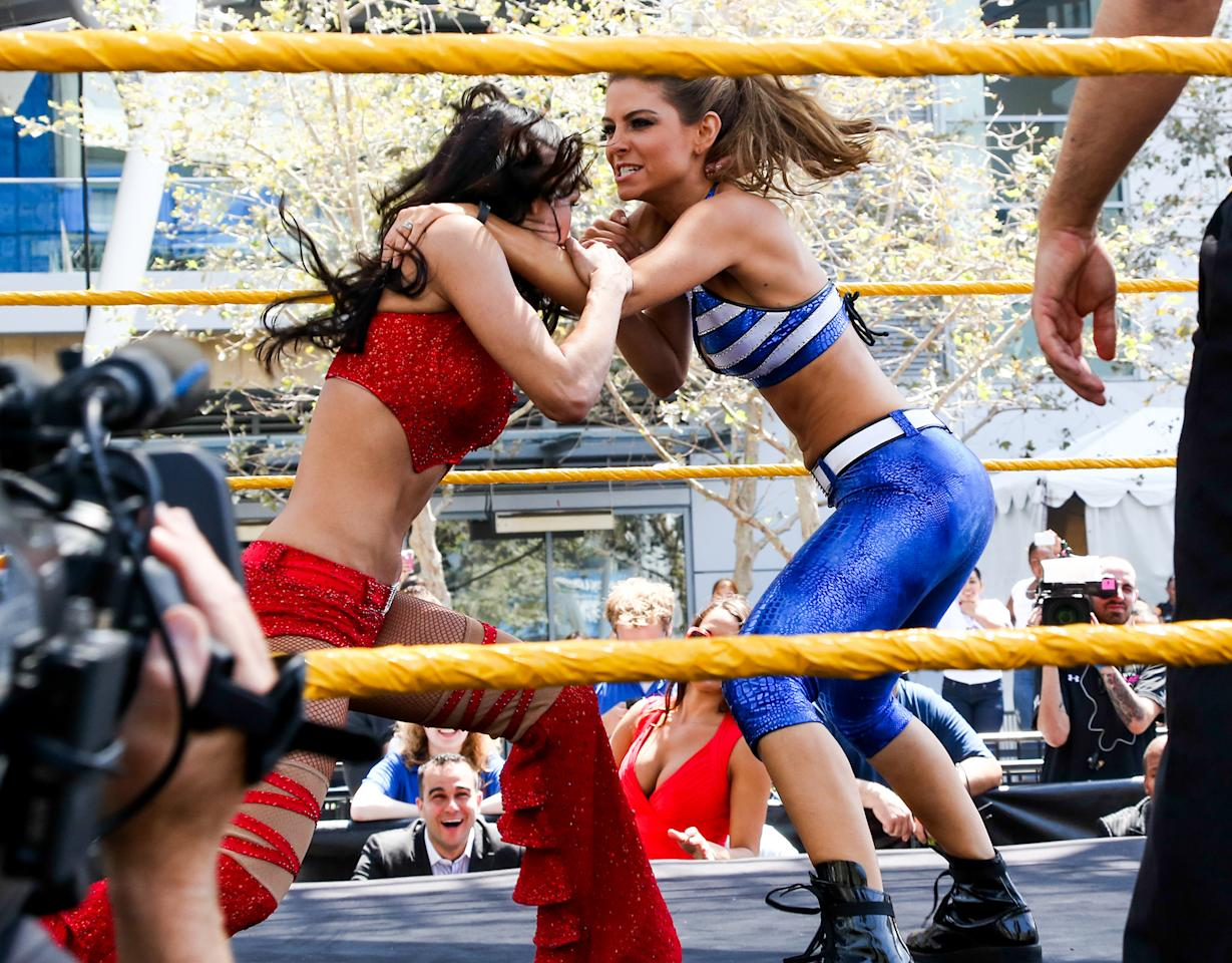 """Though she's best known as a TV personality, Maria Menounos got to show off a very different side of herself when she competed at SummerSlam Axxess on Sunday alongside """"Total Divas"""" star, Natalya. The """"Extra"""" host, 35, wore a tight blue and white spandex ensemble, but that clearly didn't get in the way of her ability to throw down! (8/19/2013)"""
