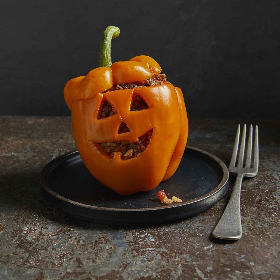 <p>Carve faces into the side of a bell pepper for a cute jack-o'-lantern you can eat too! This adorable Halloween-themed dinner is perfect for a family dinner to fuel your trick-or-treating adventure. Or serve them at a Halloween party and watch them disappear! Don't feel like freehand-carving the faces with a knife? Try using a cookie cutter instead.</p>