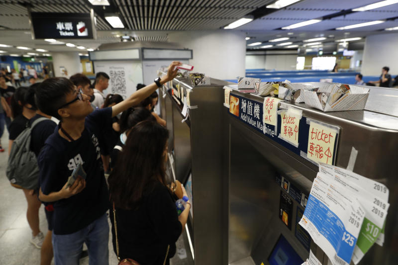 Commuters leave spare change and train tickets for protesters to use at a subway station in Hong Kong, Sunday, July 21, 2019. Protesters in Hong Kong pressed on Sunday past the designated end point for a march in which tens of thousands repeated demands for direct elections in the Chinese territory and an independent investigation into police tactics used in previous demonstrations. (AP Photo/Vincent Yu)