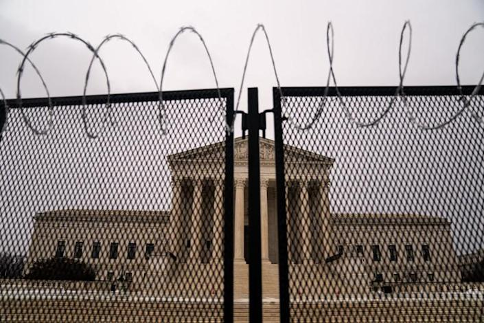 WASHINGTON, DC - FEBRUARY 22: Razor wire topped fencing is seen surrounding the Supreme Court of the United States on Monday, Feb. 22, 2021 in Washington, DC. (Kent Nishimura / Los Angeles Times)