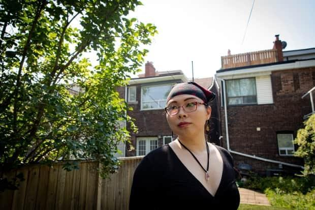 Diana Bosco, who transitioned four years ago, is attempting to get an Ontario photo card — government-issued ID for those without a driver's licence — with her 'sex designation' listed as 'F.' But she says she has only met with barriers. (Evan Mitsui/CBC - image credit)