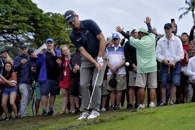 Brendan Steele chips onto the 10th green during a playoff against Cameron Smith during the final round of the Sony Open PGA Tour golf event, Sunday, Jan. 12, 2020, at Waialae Country Club in Honolulu. (AP Photo/Matt York)