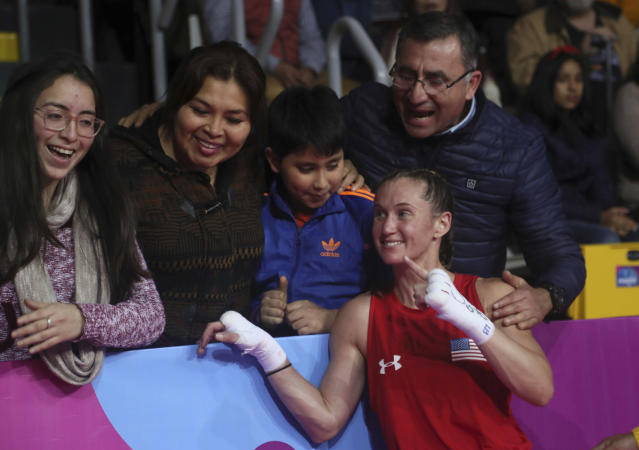 Virginia Fuchs of the United States poses with fans after her fight against Irismar Cardozo of Venezuela in the women's fly, 51 kg, boxing semifinal match at the Pan American Games in Lima, Peru, Tuesday, July 30, 2019. Fuchs won the fight and advanced to the final. (AP Photo/Fernando Llano)