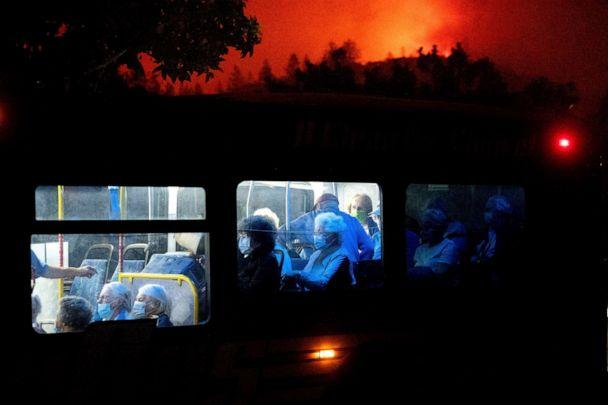 PHOTO: Residents of the Oakmont Gardens senior home evacuate on a bus as the Shady Fire approaches in Santa Rosa, Calif., Sept. 28, 2020. (Noah Berger/AP)