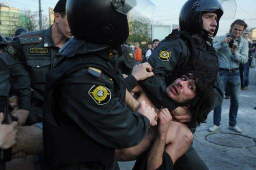 Russian police detain opposition supporters during a rally in Moscow in May 2012. The Russian lower house or State Duma has adopted a controversial bill that would greatly increase fines for protesters