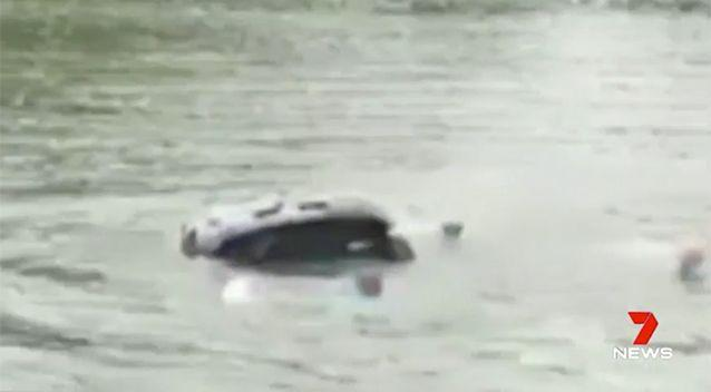 The woman was rescued moments before the car sank. Source: 7 News