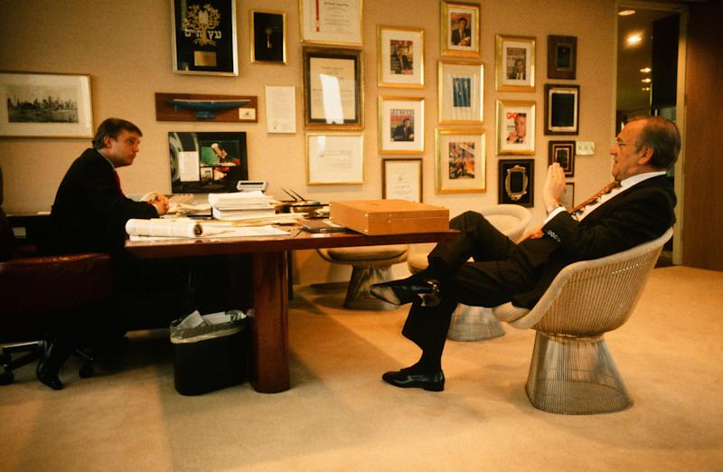 Donald Trump meets with Chrysler CEO Lee Iacocca at Trump's office in New York in 1987.
