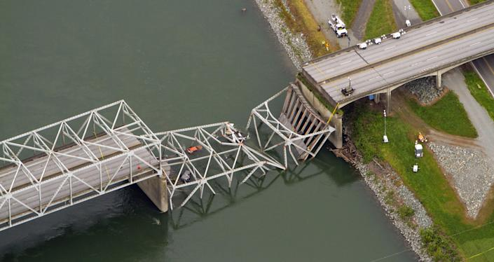 <p> A collapsed section of the Interstate 5 bridge over the Skagit River is seen in an aerial view Friday, May 24, 2013. Part of the bridge collapsed Thursday evening, sending cars and people into the water when a an oversized truck hit the span, the Washington State Patrol chief said. Three people were rescued from the water. Washington Gov. Jay Inslee on Friday declared a state of emergency in three counties around the bridge, saying that the bridge collapse has caused extensive disruption, impacting the citizens and economy in Skagit, Snohomish and Whatcom Counties. (AP Photo/The Seattle Times, Mike Siegel)</p>