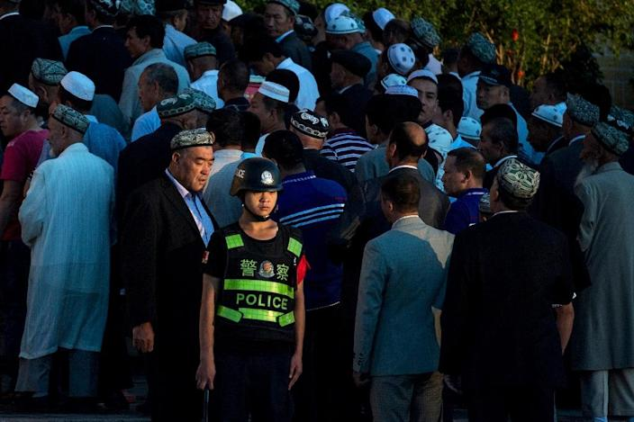 """China blames unrest in Xinjiang province on an organised """"terrorist"""" movement, while Uighurs say it stems from Chinese cultural and religious repression (AFP Photo/Johannes EISELE)"""