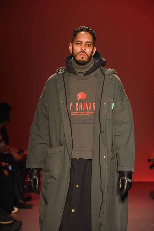 <p>A model in a winter coat on the runway at Willy Chavarria. (Photo: Getty Images) </p>