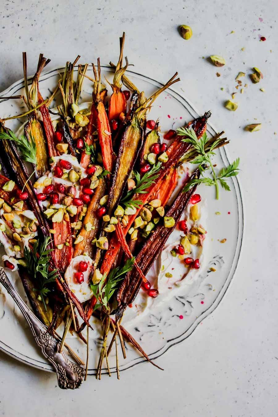 "<p>This fancy carrot recipe is just as good as it sounds. Pair it with a meat-filled meal for great results.</p> <p><b>Get the recipe</b>: <a href=""http://dishingouthealth.com/5-ingredient-pomegranate-glazed-carrots-with-whipped-goat-cheese/"" class=""link rapid-noclick-resp"" rel=""nofollow noopener"" target=""_blank"" data-ylk=""slk:pomegranate-glazed carrots with whipped goat cheese"">pomegranate-glazed carrots with whipped goat cheese</a></p>"