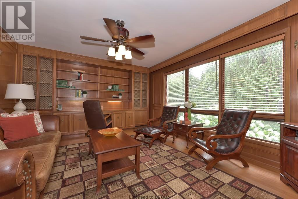 """<p><a rel=""""nofollow"""">1058 Fraser Ave., London, Ont.</a><br /> The classically-designed home sits on a quiet tree-lined street, and brings some of that wooded feel inside with this paneled office.<br /> (Photo: Zoocasa) </p>"""