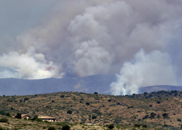 <p>A fire burns near Mayer, Ariz, Wednesday, June 28, 2017, as seen from Spring Valley, Ariz. The fire has burned over 28 square miles (73 square kilometers). More than 500 firefighters are battling the blaze that's near the small town where 19 members of an elite firefighting unit were killed while battling a blaze four years ago. (AP Photo/Matt York) </p>
