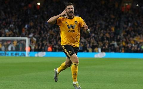 Ruben Neves of Wolverhampton Wanderers celebrates after scoring the first goal during the Premier League match between Wolverhampton Wanderers and Arsenal  - Credit: GETTY IMAGES