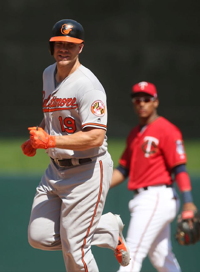 Baltimore Orioles' Chris Davis runs the bases on a solo home run off Minnesota Twins pitcher Matt Magill in the ninth inning of a baseball game Sunday, July 8, 2018, in Minneapolis. The Twins won 10-1, sweeping the four-game series. (AP Photo/Jim Mone)
