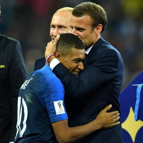 Mr Macron kissed Kylian Mbappé on the head before France were presented with the cup - Credit: DYLAN MARTINEZ/ REUTERS