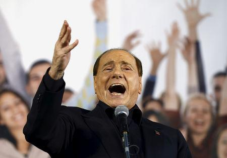FILE PHOTO: Berlusconi speaks during Northern League rally in Bologna