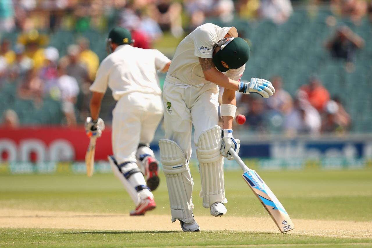 ADELAIDE, AUSTRALIA - NOVEMBER 25:  Australian captain Michael Clarke is hit by the ball whilst running between the wickets during day four of the Second Test Match between Australia and South Africa at Adelaide Oval on November 25, 2012 in Adelaide, Australia.  (Photo by Cameron Spencer/Getty Images)