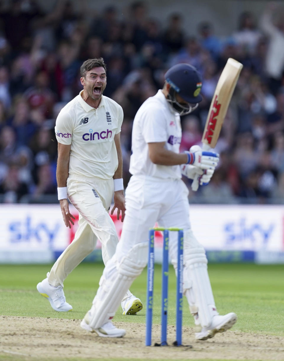England's James Anderson, left, celebrates the dismissal of India's captain Virat Kohli, right, during the first day of third test cricket match between England and India, at Headingley cricket ground in Leeds, England, Wednesday, Aug. 25, 2021. (AP Photo/Jon Super)