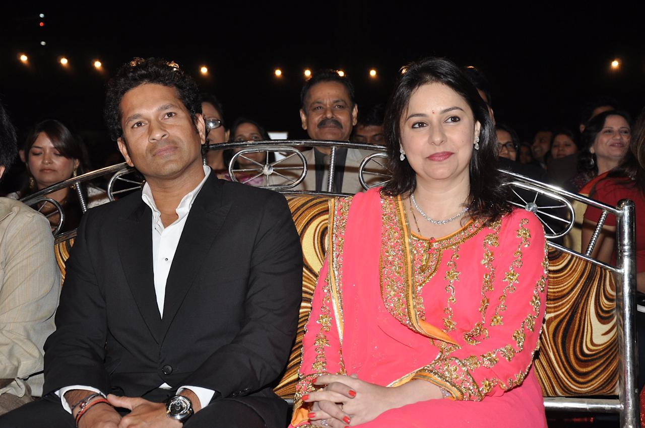MUMBAI, INDIA - JANUARY 5: Indian Cricketer Sachin Tendulkar with wife Anjali Tendulkar during the Umang Mumbai Police Annual Show 2013 at Andheri Sports Complex on January 5, 2013 in Mumbai, India. (Photo by Amlan Dutta/Hindustan Times via Getty Images)