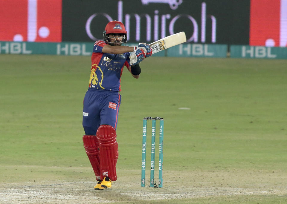 Karachi Kings Babar Azam plays a shot against Lahore Qalandars during the final of their Pakistan Super League T20 cricket match at National Stadium in Karachi, Pakistan, Tuesday, Nov. 17, 2020. (AP Photo/Fareed Khan)