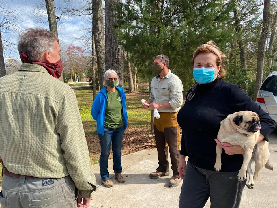 Botanical experts met with the Hammers to discuss their fig buttercup invasion. From left to right, Johnny Randall, Ann Prince, Pete Schubert and Valerie Hammer, holding her pug Bonnie.