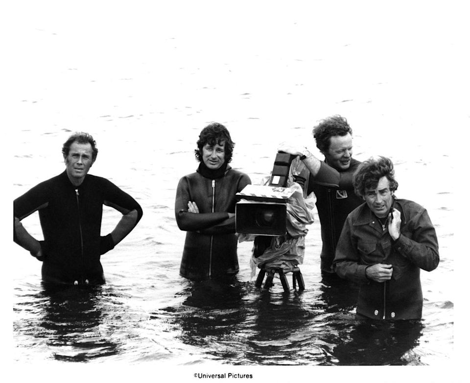 <p>Director Steven Spielberg, camera operator Michael Chapman, and cinematographer Bill Butler wade into the water of Martha's Vineyard, Massachusetts while filming <em>Jaws</em>. </p>