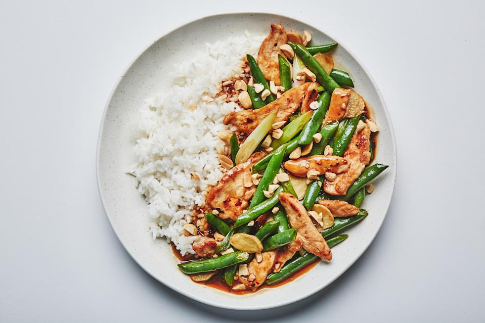 """<a href=""""https://www.bonappetit.com/recipe/chicken-and-green-bean-stir-fry?mbid=synd_yahoo_rss"""" rel=""""nofollow noopener"""" target=""""_blank"""" data-ylk=""""slk:See recipe."""" class=""""link rapid-noclick-resp"""">See recipe.</a>"""