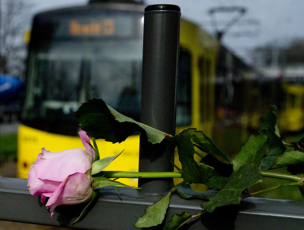 A tram passes a rose at the site of a shooting incident in a tram in Utrecht, Netherlands, March 19, 2019. (Photo: Peter Dejong/AP)