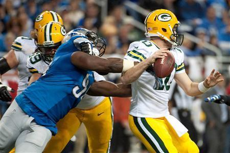 Detroit Lions defensive end Ezekiel Ansah (94) sacks Green Bay Packers quarterback Matt Flynn (10) during the second quarter during a NFL football game on Thanksgiving at Ford Field. Mandatory Credit: Tim Fuller-USA TODAY Sports