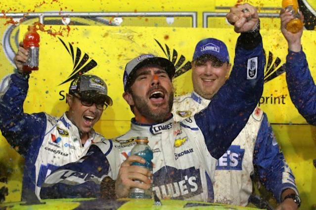 Jimmie Johnson celebrates winning his record-tying seventh title. (Getty Images)