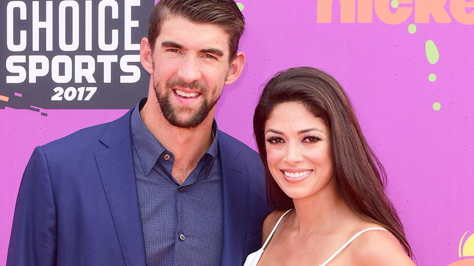 Seen here, Michael Phelps and wife Nicole at an awards night.
