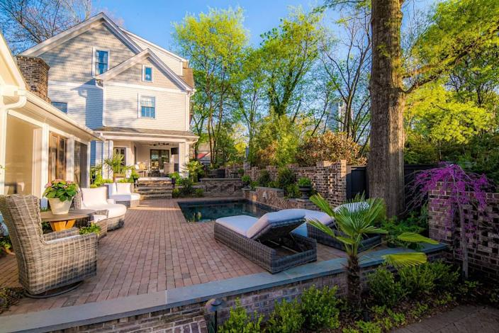 This Charleston-inspired oasis garden on 9th Street in Charlotte spans across two homes.