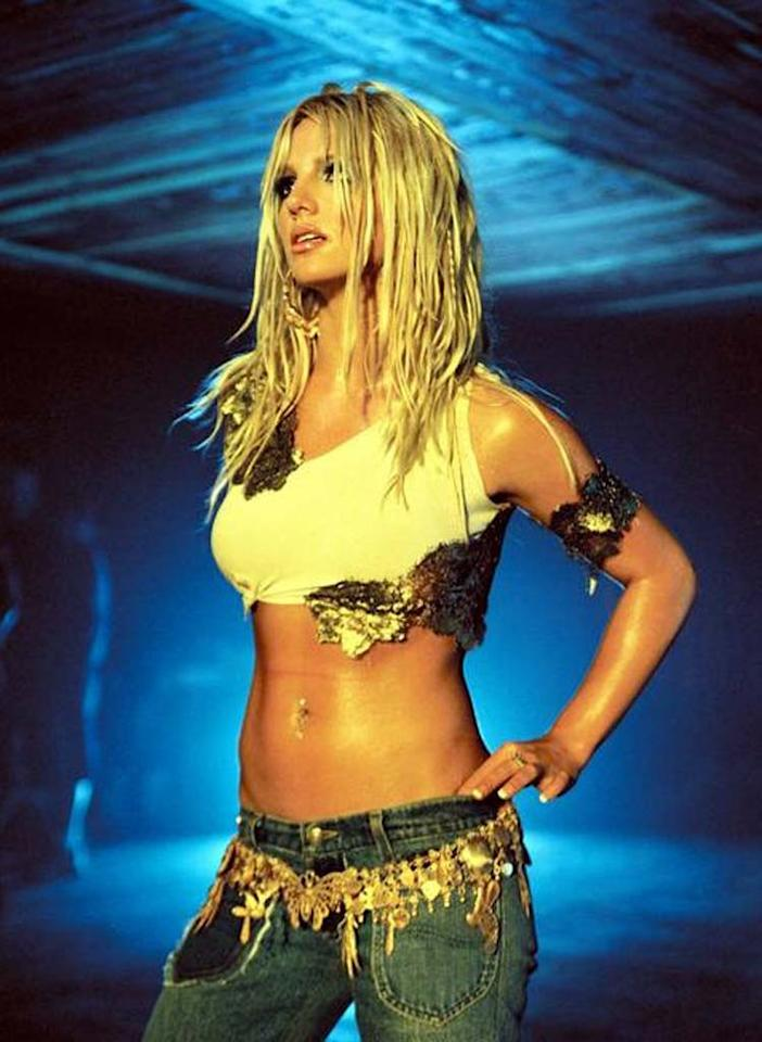 """<b>Britney Spears in """"I'm a Slave 4 U,"""" 2001:</b> With her sculpted abs and curvaceous rear, Britney Spears was made to wear the ultra low-rise jeans that marked the millennium. In her steamy video for """"I'm a Slave 4 U,"""" the pop star writhed around in a barely-there costume, inspiring sit-ups.   <b><a href=""""http://www.instyle.com/instyle/package/transformations/photos/0,,20290121_20331288_20719623,00.html?xid=omg-gaga-trans?yahoo=yes"""" target=""""new"""">See Lady Gaga's Style Transformation</a></b> Courtesy Jive Records - 2001"""
