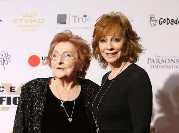 PHOTO: Reba McEntire and her mother, Jacqueline McEntire arrive at Muhammad Ali's 22nd Celebrity Fight Night held at JW Marriott Desert Ridge Resort & Spa on April 9, 2016, in Phoenix. (Michael Tran/FilmMagic via Getty Images)