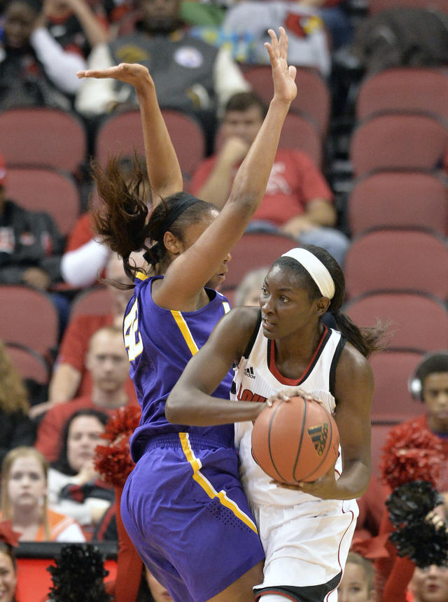 Louisville's Asia Taylor, right, tries to pass around the pressure of LSU's Sheila Boykin during the first half of an NCAA college basketball game on Thursday, Nov. 14, 2013, in Louisville, Ky. (AP Photo/Timothy D. Easley)