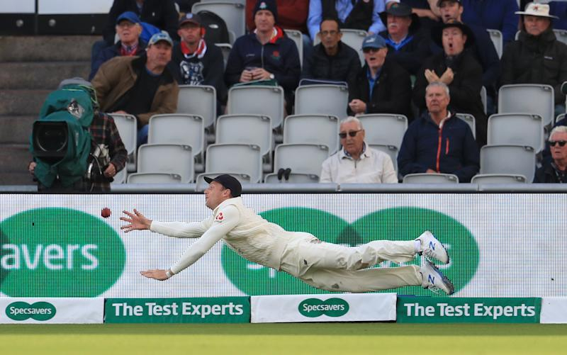 England's Jos Buttler attempts to catch out Australia's Mitchell Starc only for the ball to go for six runs during day two of the fourth Ashes Test at Emirates Old Trafford, Manchester. (Photo by Mike Egerton/PA Images via Getty Images)